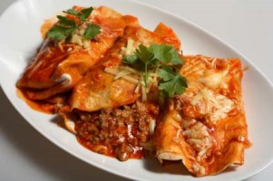 Texan/Mexican-style enchiladas, tortillas filled with spicy beef topped with grated cheese and tomato-chili salsa.